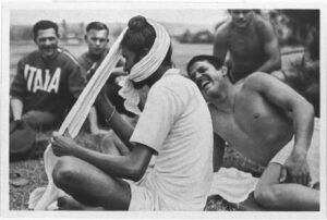 Berlin 1936: An Indian athlete puts his turban with Italian athletes around him