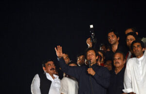 Pakistani opposition politician Imran Khan (C) addresses supporters after reaching the parliament during an anti-government march in Islamabad.