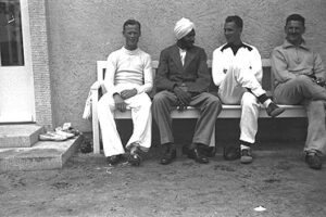 Berlin 1936: A member of the Indian delegation amongst other participants