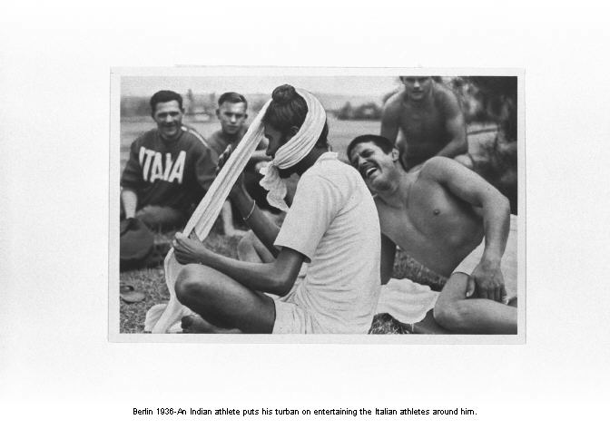Berlin 1936: An Indian athlete tying his turban with Italian athletes around him