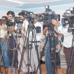tv camermen at press conference
