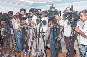 tv camermen at press conference